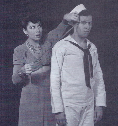 woman and man in black and white, woman is measuring distance from sailor's head to something On The Town lecture about sailors in New York by Richard Hanson