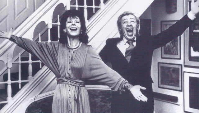 two people in black and white, singing with their arms outstretched. Betty Comden and Adolph Green in Richard Hanson's Fall 2019 lecture
